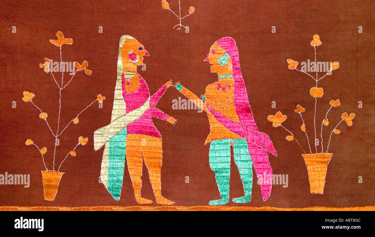 Detail of an embroidered Pulkhari textile from India Depicting Indian women in Saris Stock Photo
