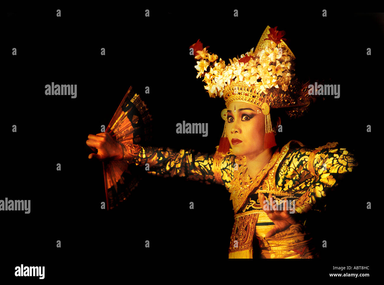 Balinese dancer at night performance Legong dancers Ubud Bali Indonesia Black background Photo by Jamie Marshall Stock Photo