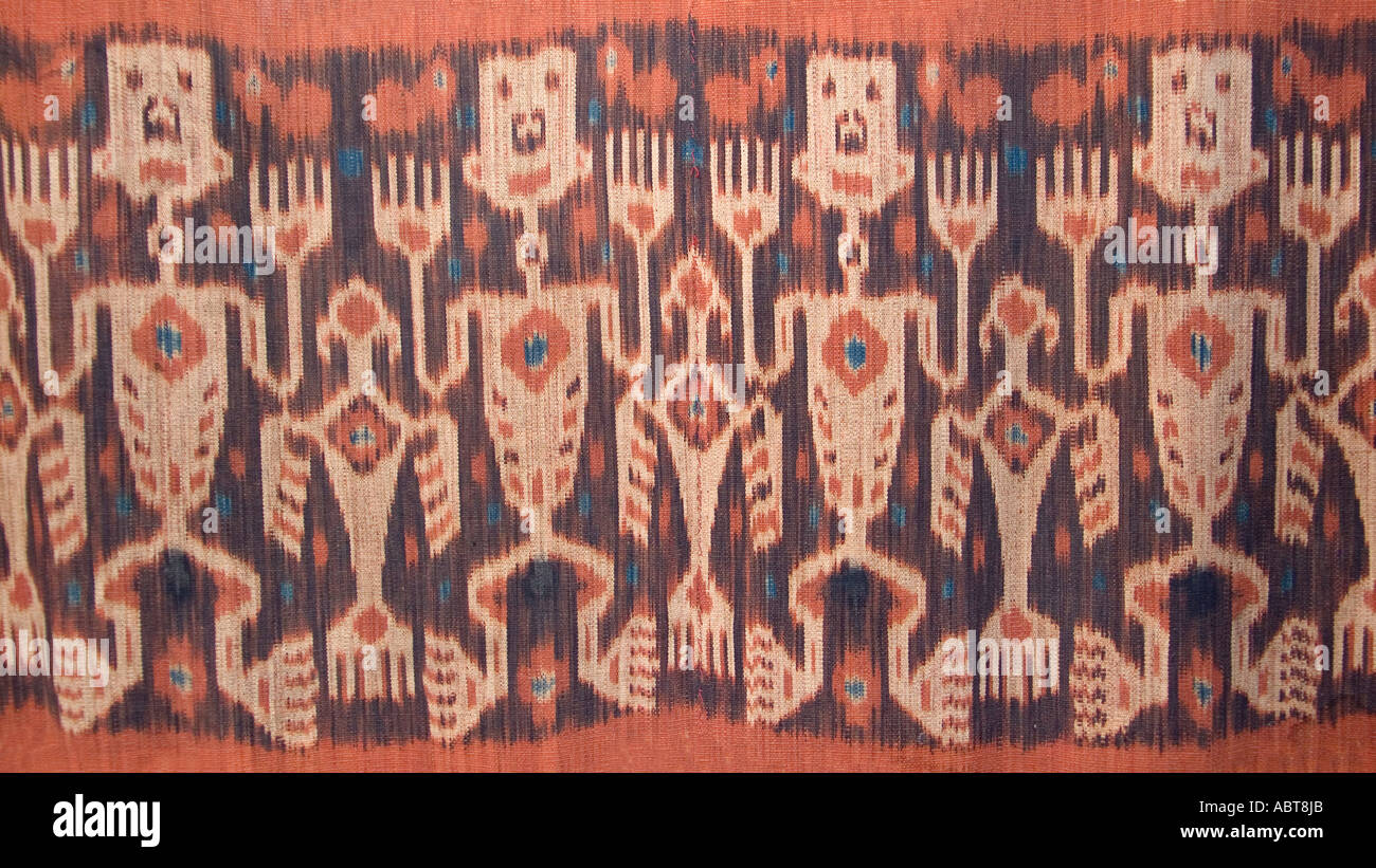 Detail of anthropomorphic motifs on a Sumbanese hinggi Ikat patterned textile Sumba Nusa Tengarra Indonesia Stock Photo