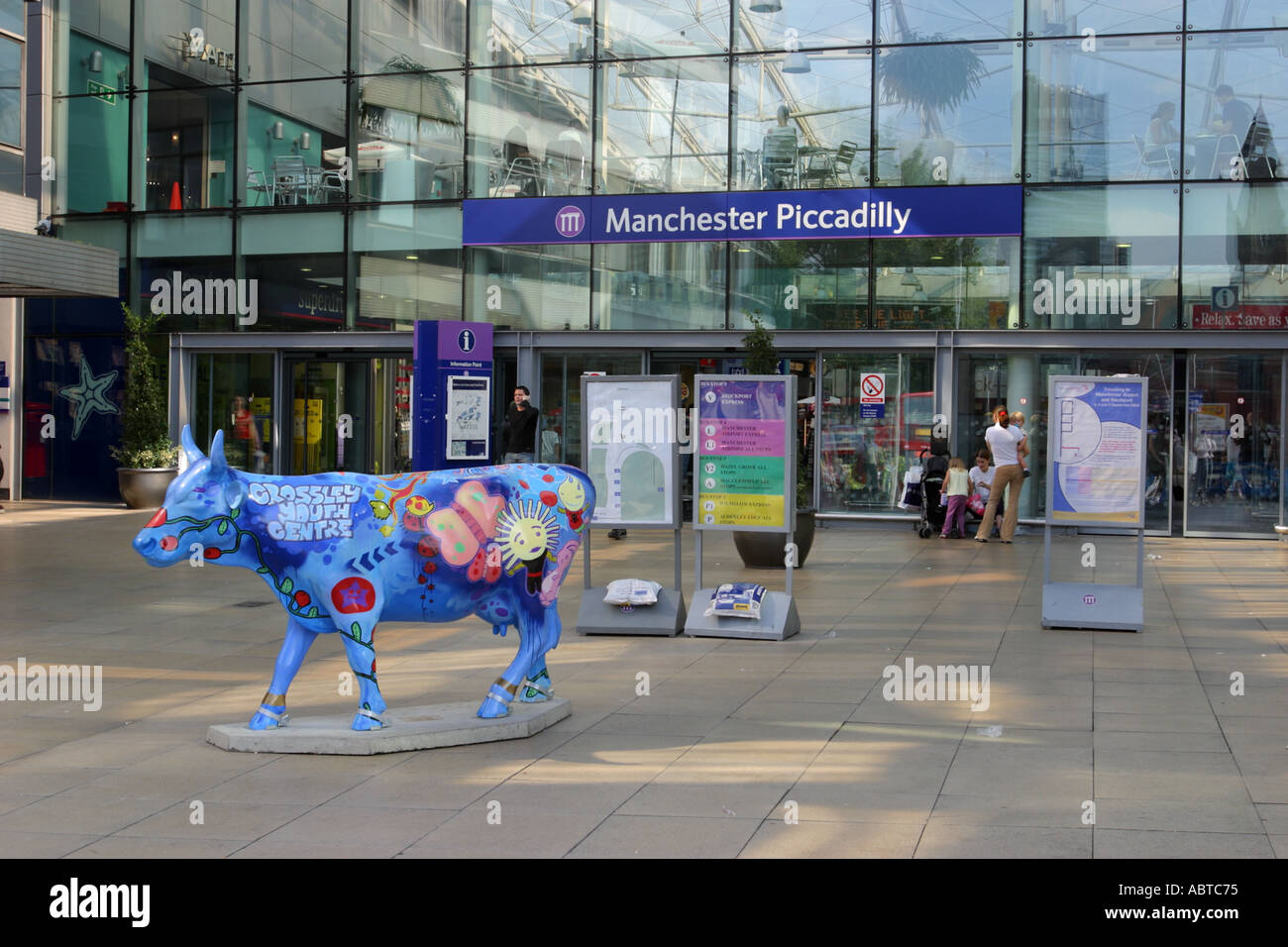 Piccadilly train station Station Approach entrance showing cow from Cow Parade Manchester 2004 UK - Stock Image
