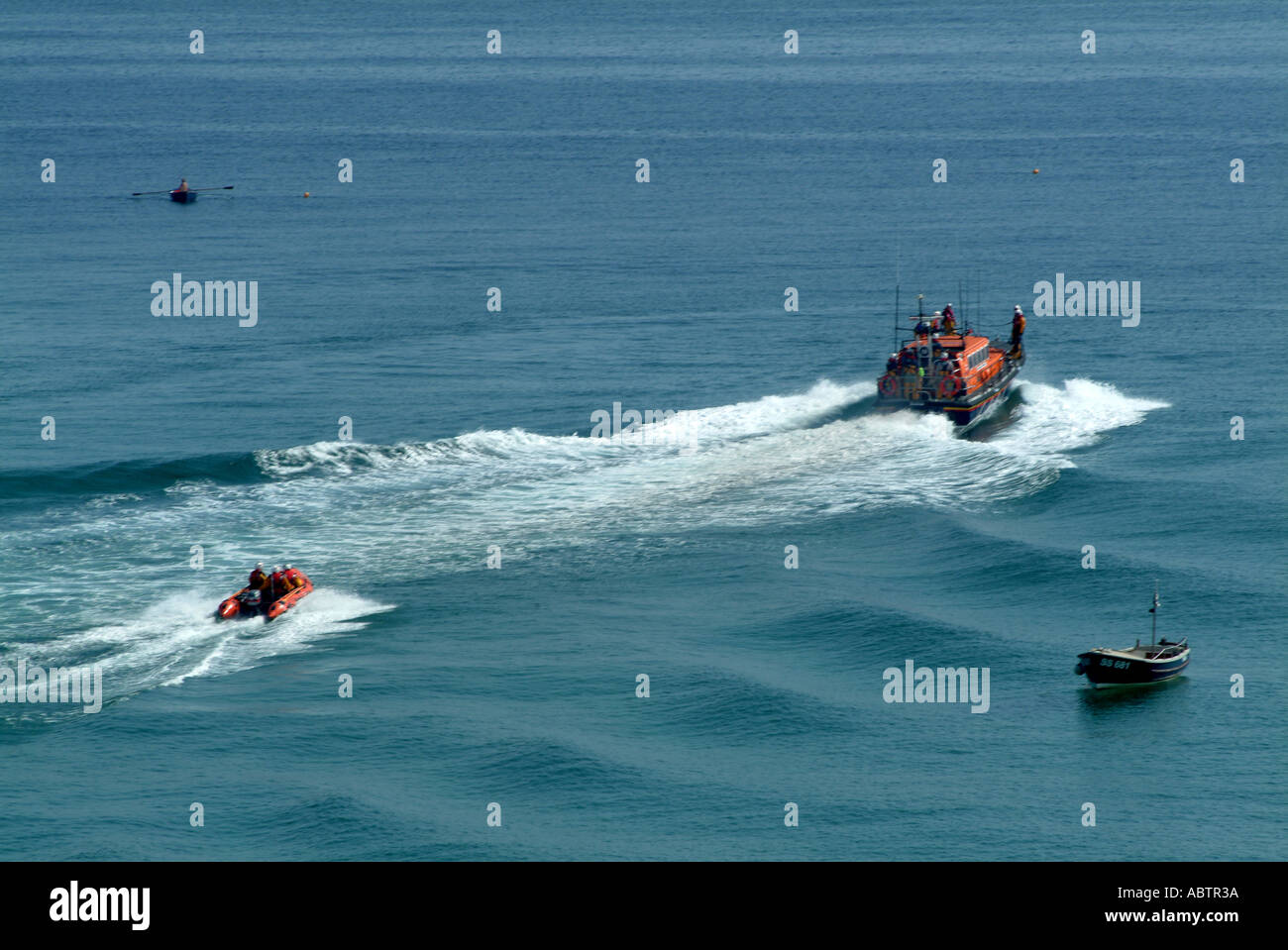 Mersey and D Class Lifeboats Leaving St Ives Harbour on Clear Sunny Day Cornwall - Stock Image