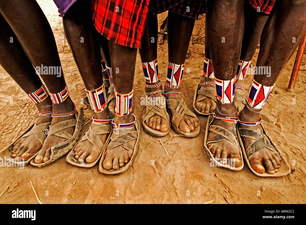 Maasai people Close up of leather sandals and intricate beadwork on the  Maasai men feet Kenya 32a792731