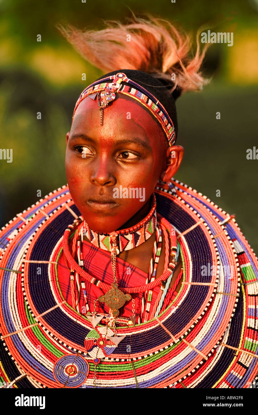 Maasai woman Popular necklaces worn by Maasai is a flat disc that surrounds the neck made up of beads Model released Kenya - Stock Image