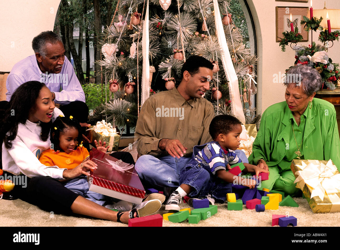 affluent three generation black afro american family enjoy the giftgiving spirit of the christmas season under - Black Family Christmas Pictures