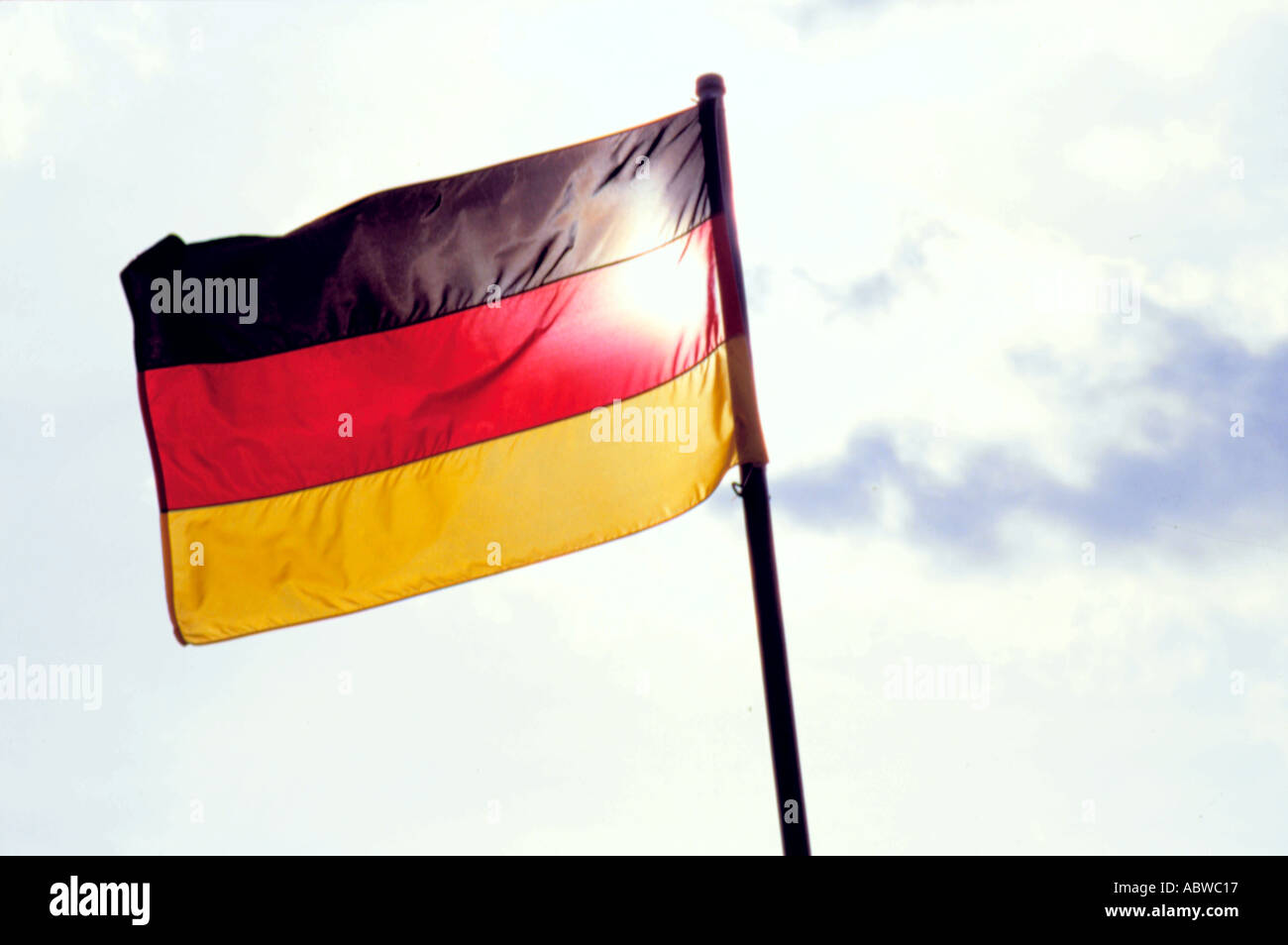 German flag blowing in the wind. - Stock Image