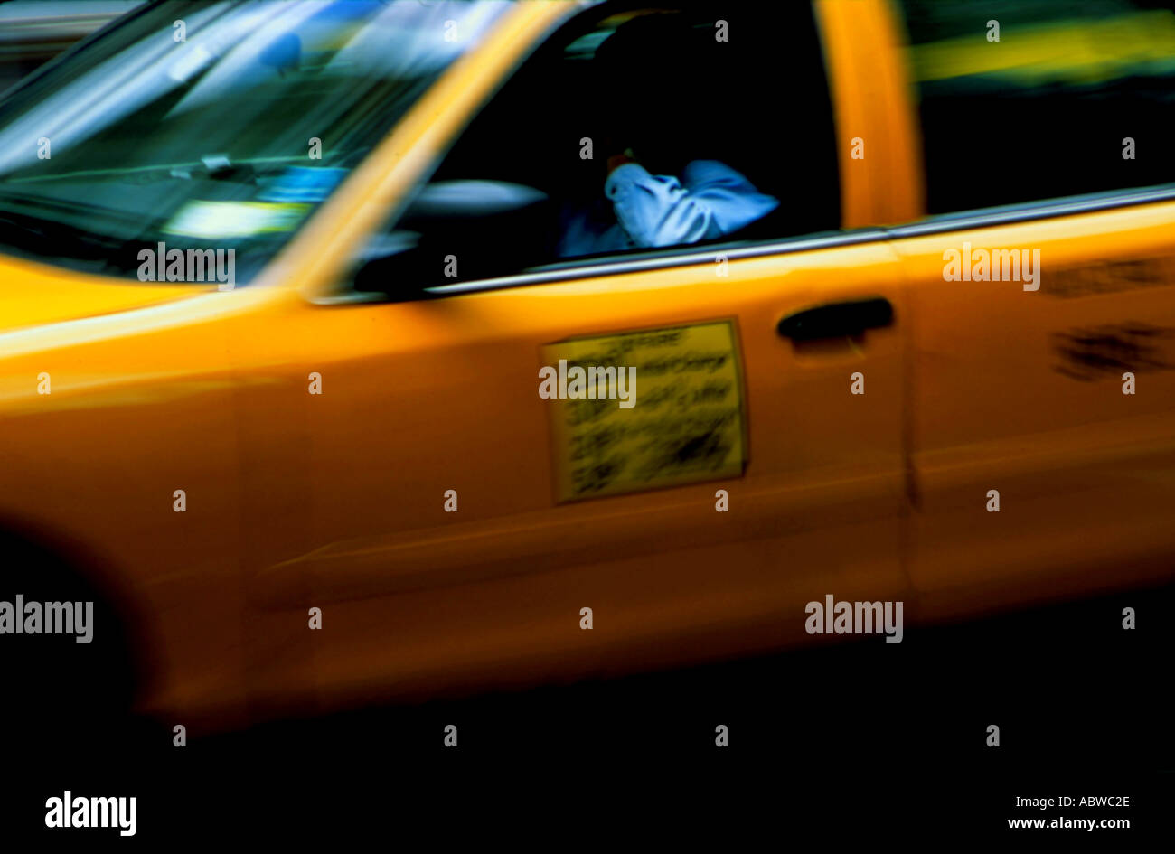 A New York taxicab in motion. - Stock Image