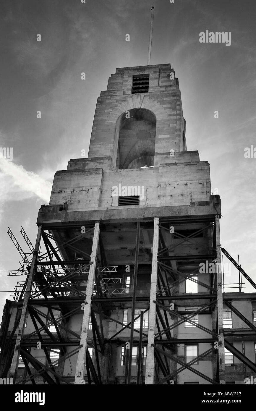 London building being demolished with preservation of clock tower Abbey House. ONLY FOR EDITORIAL USE. - Stock Image