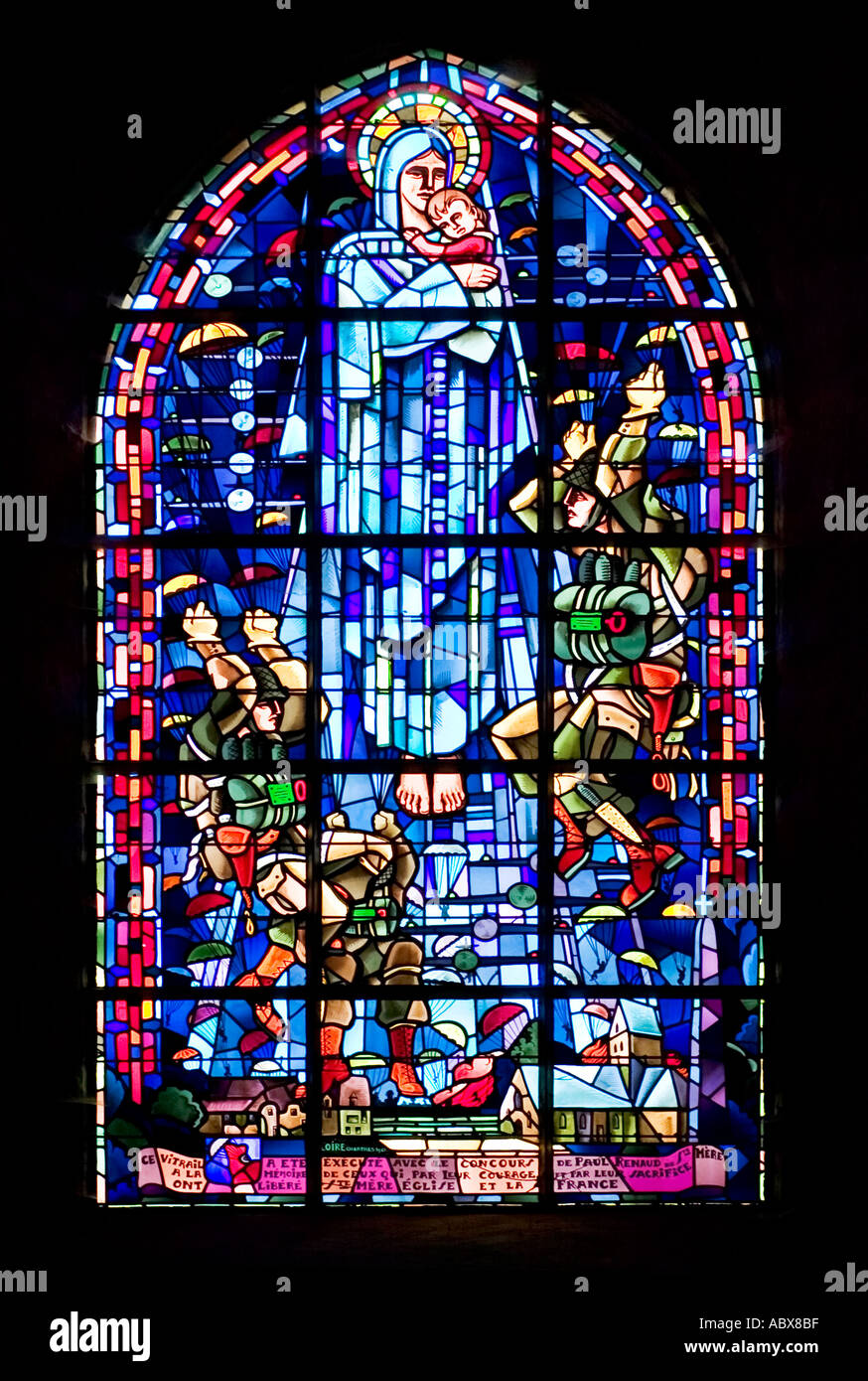 Stained glass window with liberating parachutists and aeroplanes around the Virgin Mary in St Mere Eglise, Normandy, Stock Photo