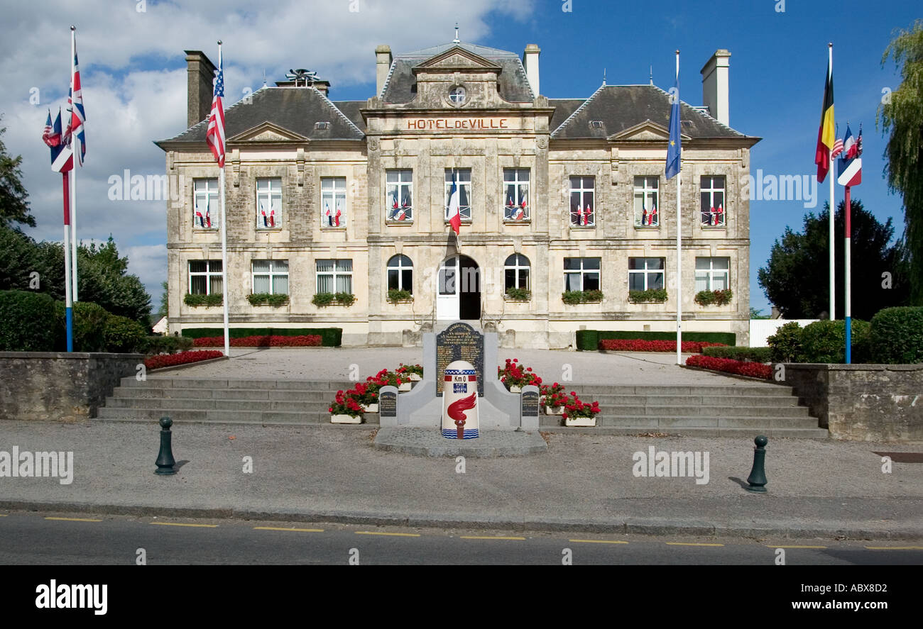 Memorial Liberation Stone at Km0 and the Town Hall - Hotel de Ville - in St Mere Eglise, Normandy, France - Stock Image