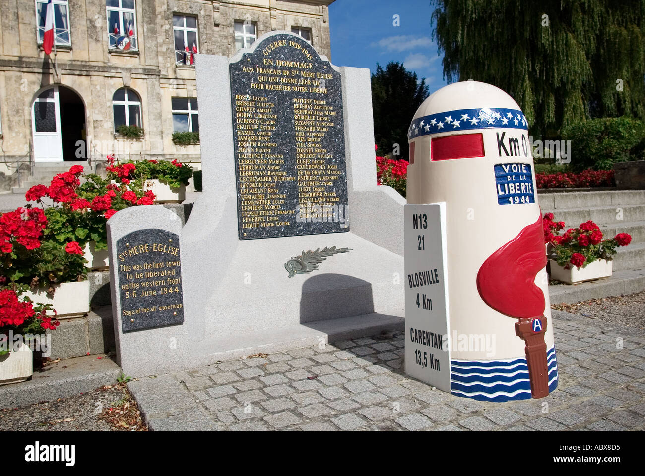 D Day liberation stone at zero Km outside the Town Hall in St Mere Eglise, Normandy, France Stock Photo