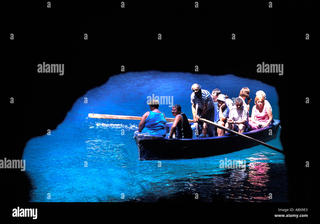 Tourists embark on a quick boat tour of Melissani Lake and cave Kefalonia Ionian Islands Greece - Stock Image