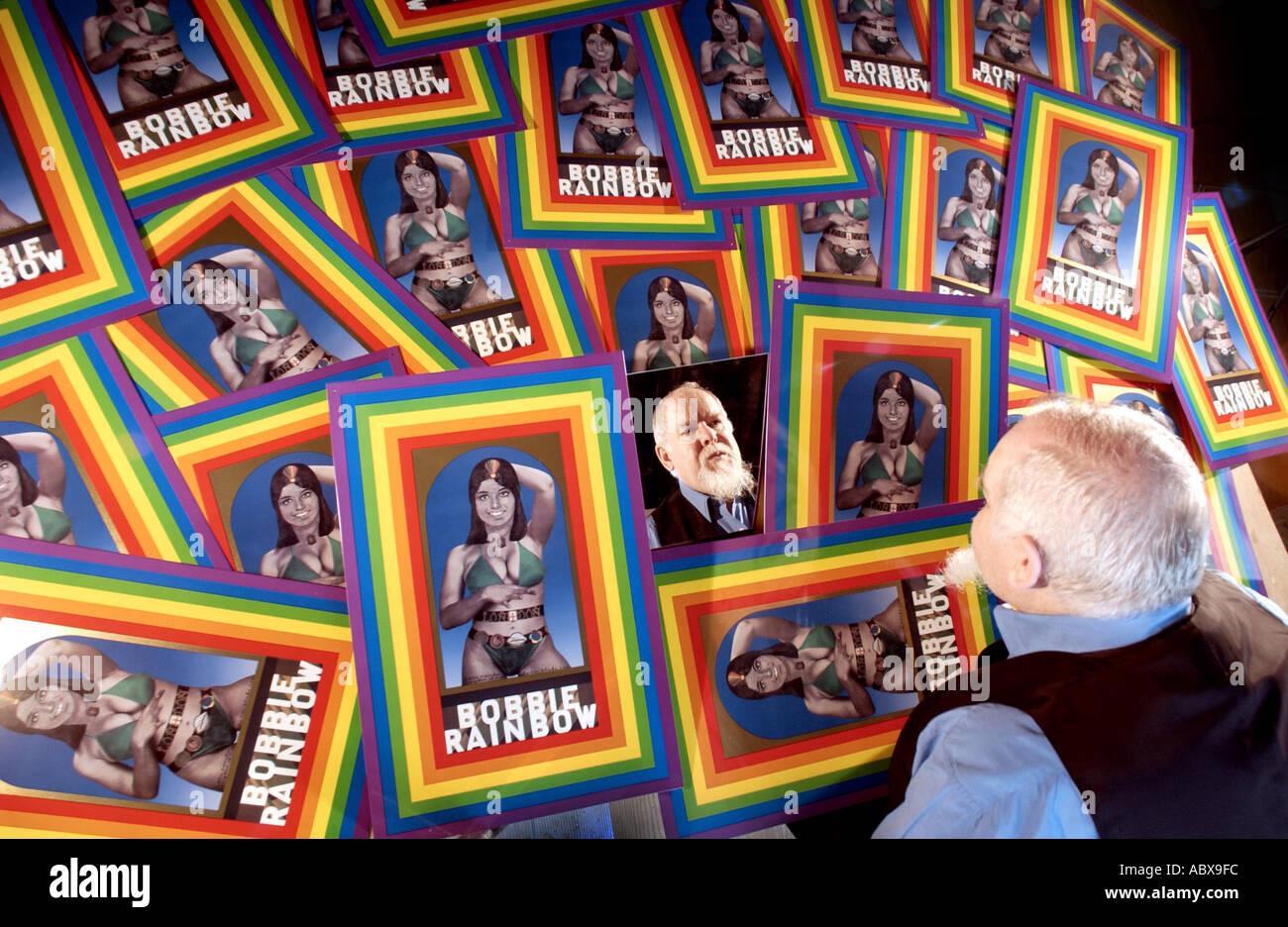 Artist Peter Blake with Bobbie Rainbow tinplate prints. - Stock Image