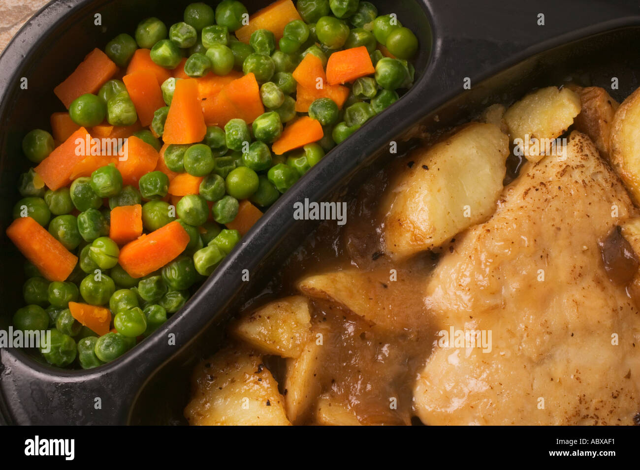 Close up of TV dinner chicken and gravy - Stock Image