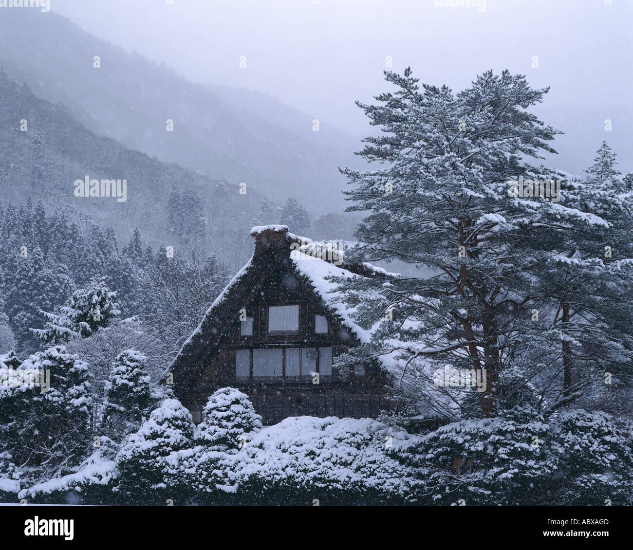 Snow covered house in Shirakawa Village Gifu Japan - Stock Image