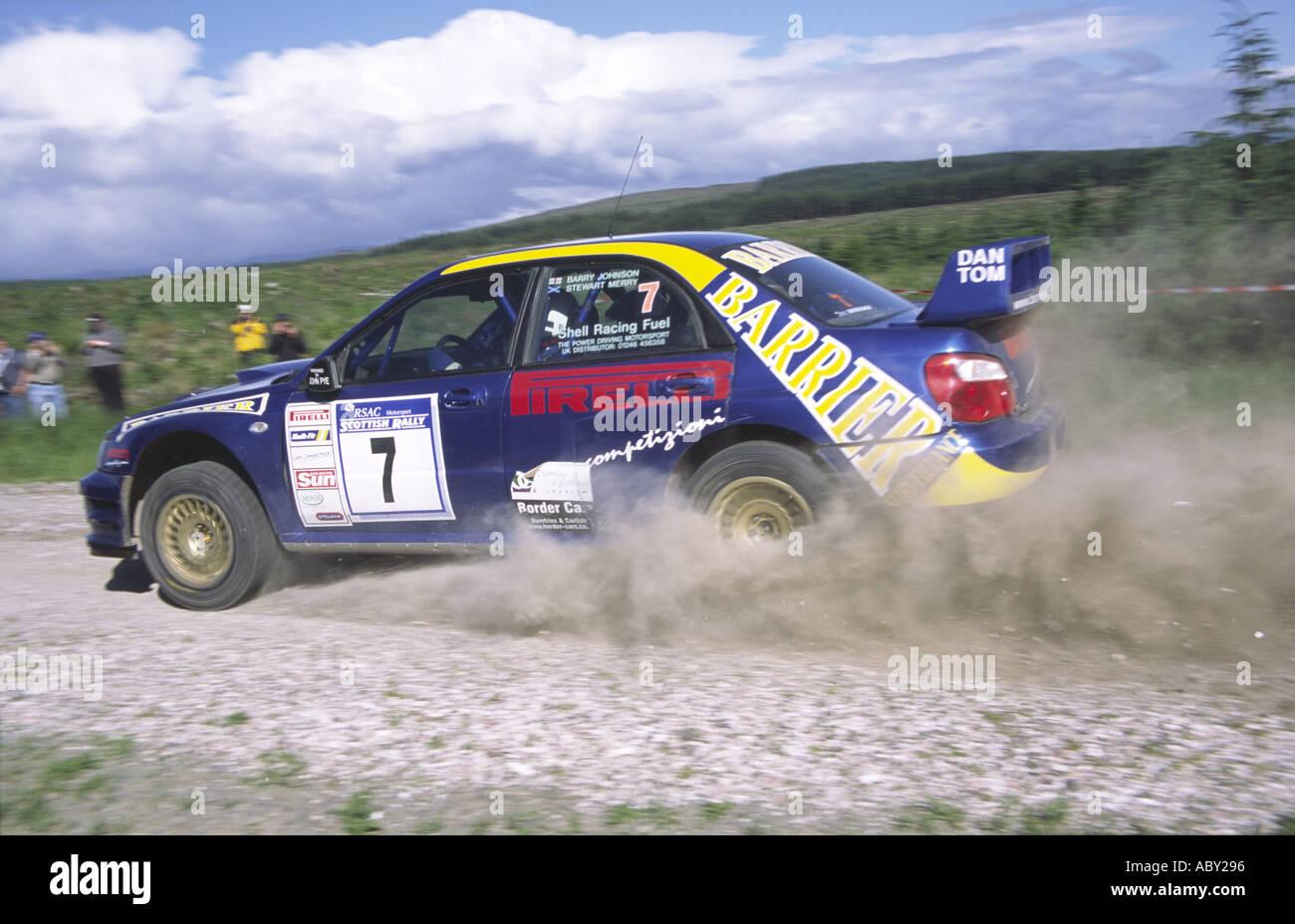 RSAC Scottish Rally cornering rally car kicking up the dust - Stock Image