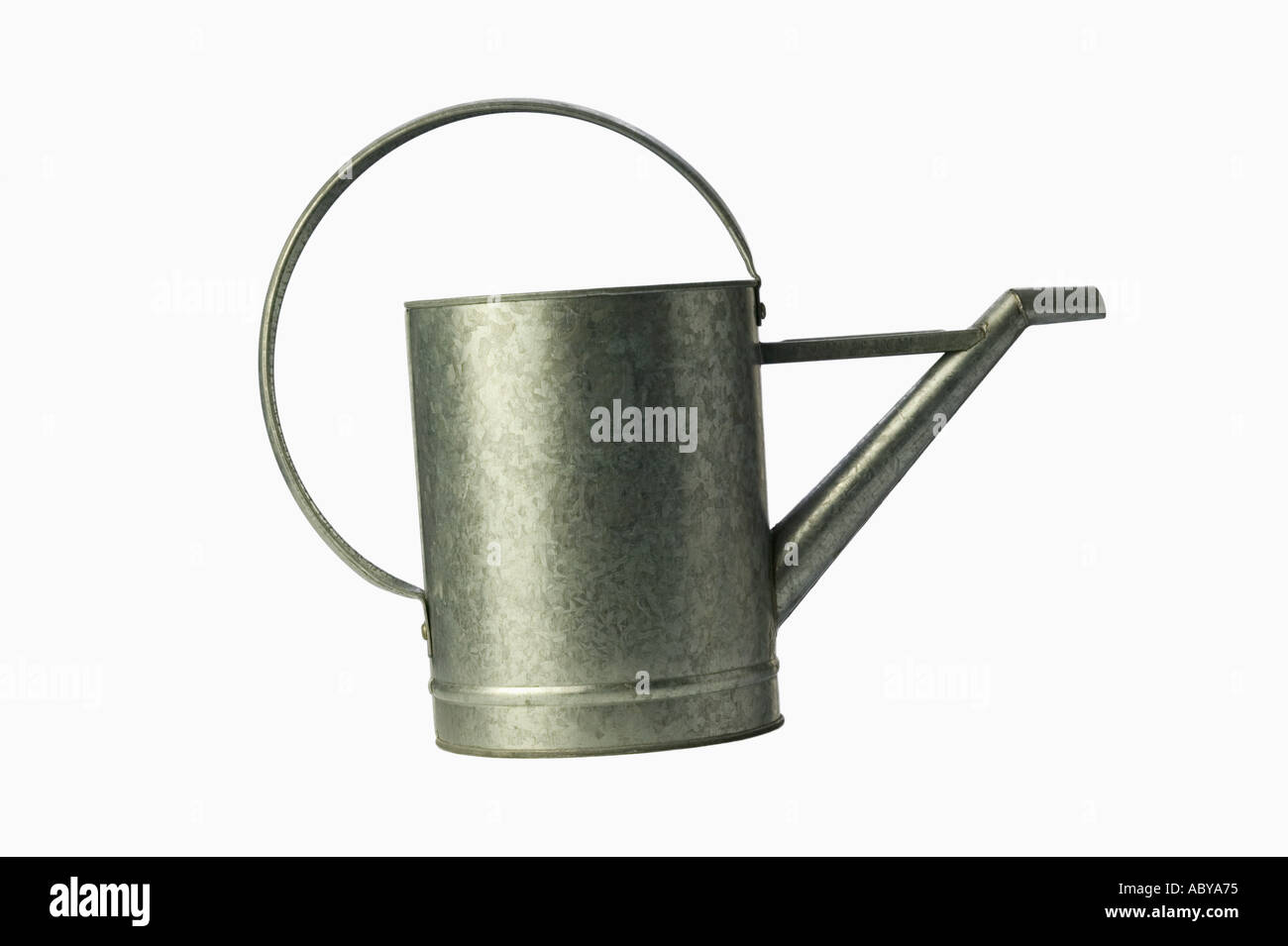 Still life of a galvanize steel watering can on white background - Stock Image