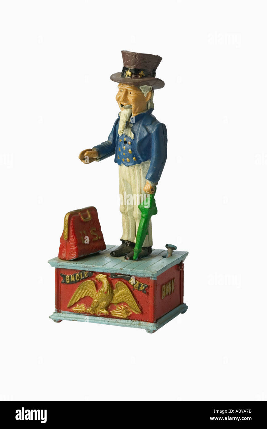 Still life of an Antique metal Uncle Sam coin bank silhouetted on white background - Stock Image