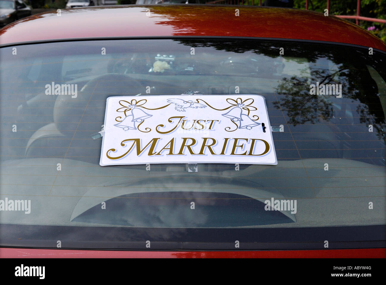 Just Married sign pinned to the back of a car - Stock Image