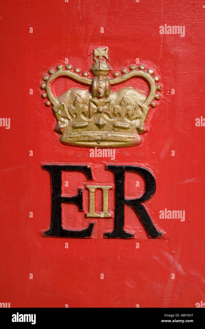 Gold painted ER II crown badge on post box Wales UK - Stock Image