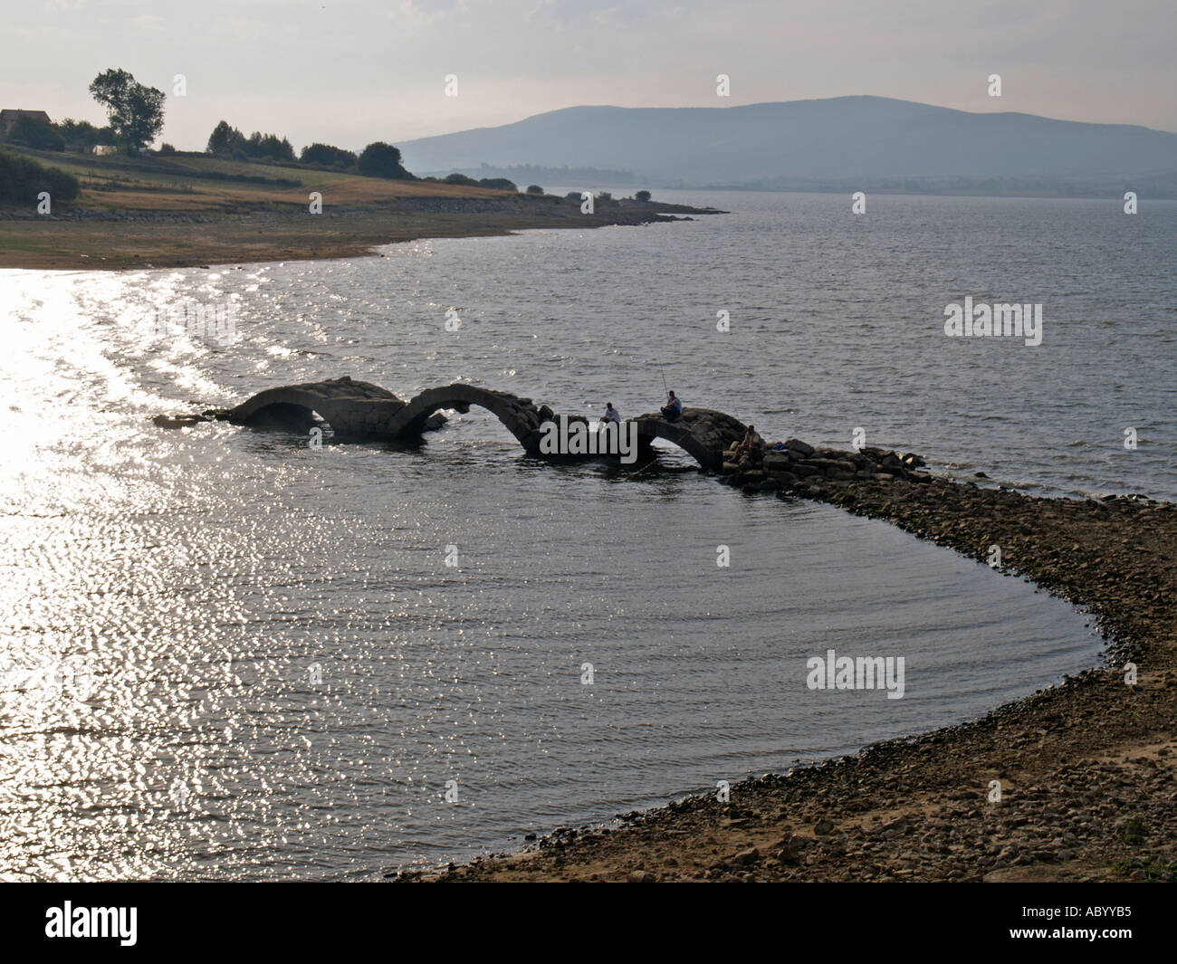 fishing in old bridge in the Ebro's lake - Stock Image