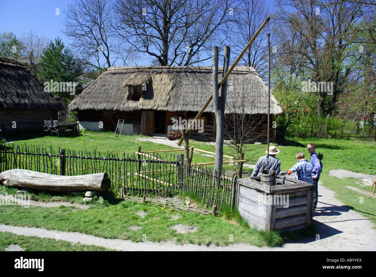 Crane well in Zagroda Guciow farm open air folk museum in Roztocze region Poland Stock Photo