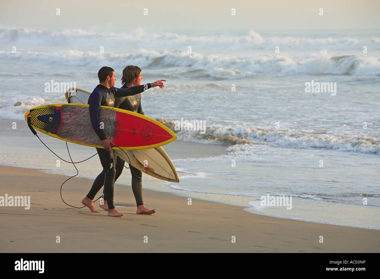 Surfers walking   Hunington Beach Orange County California United States MR Stock Photo