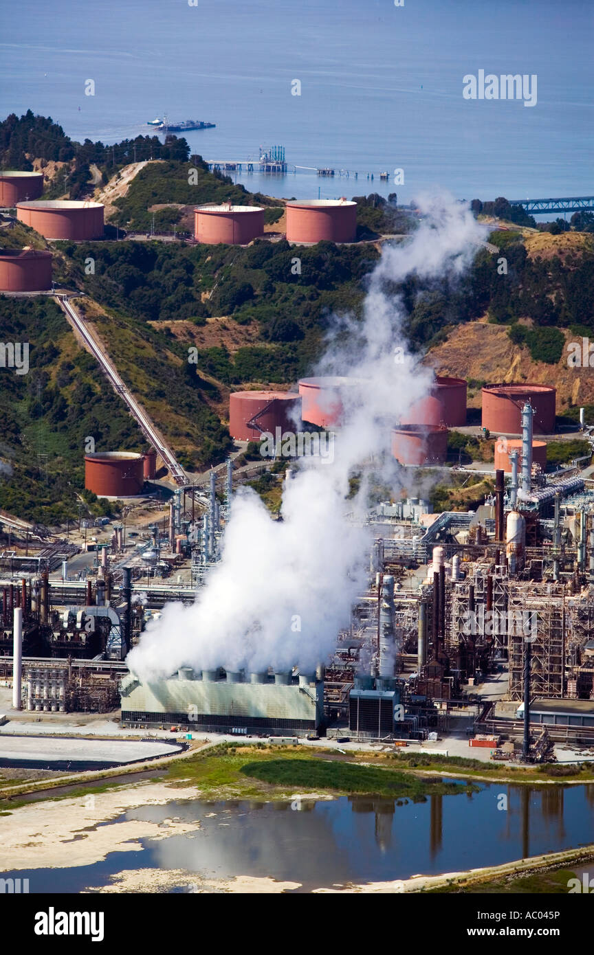 aerial above steam  from the Chevron refinery Richmond California at the edge of San Francisco bay in Contra Costa Stock Photo
