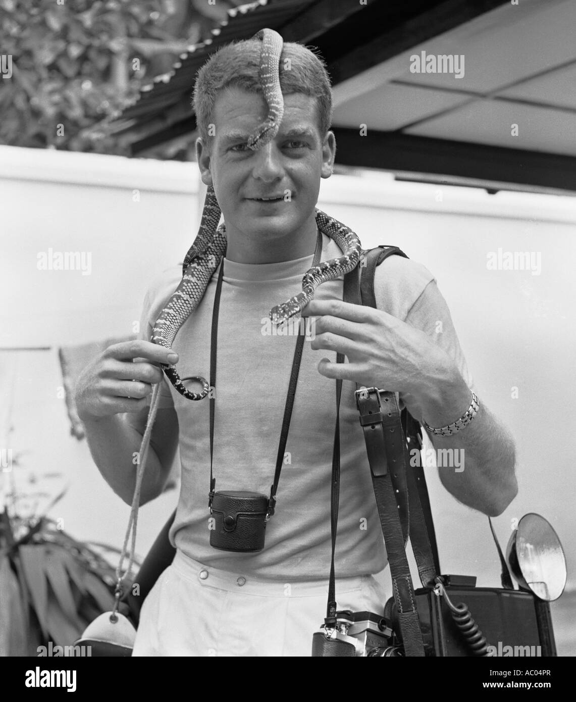 James Davis travel photographer aged 23 in 1966 when a ship's photographer was photographed at the Snake Temple - Stock Image