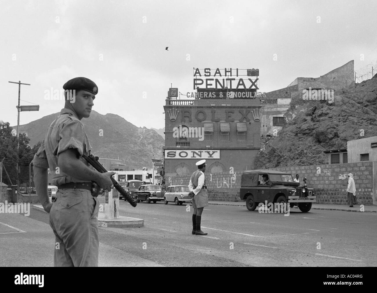 Soldiers patrol on a main street in Aden at the time of the troubles with Britain in 1966 Pentax sign in the then - Stock Image
