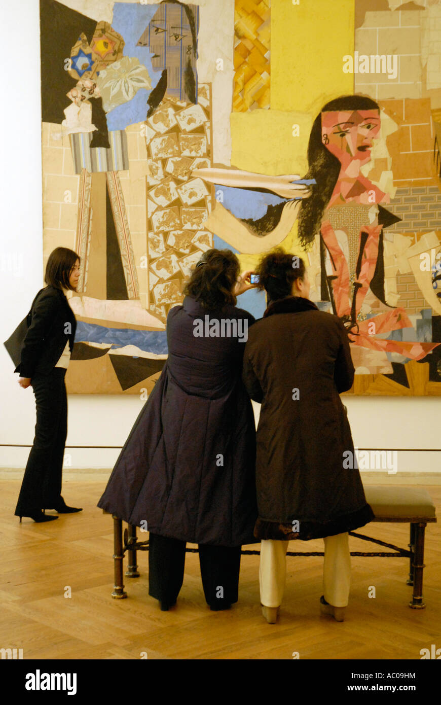 Viewing paintings at Museum in Paris. Stock Photo