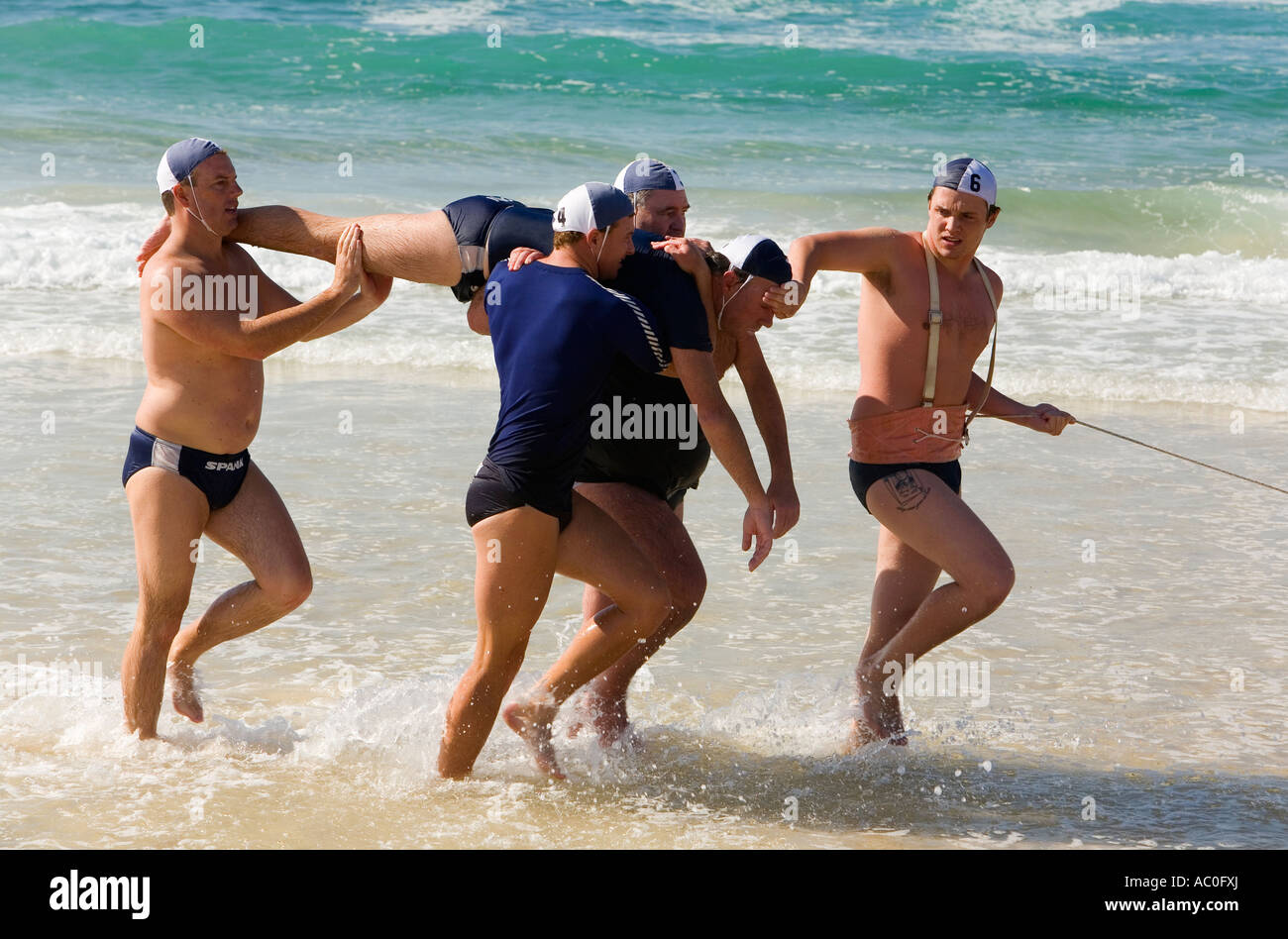 Lifesavers Practice A Surf Rescue On Bondi Beach Using The Stock Photo Alamy