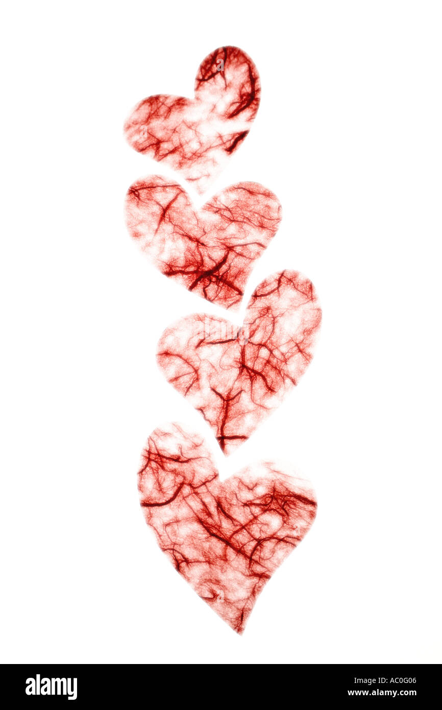 Red paper hearts on bright white background - Stock Image