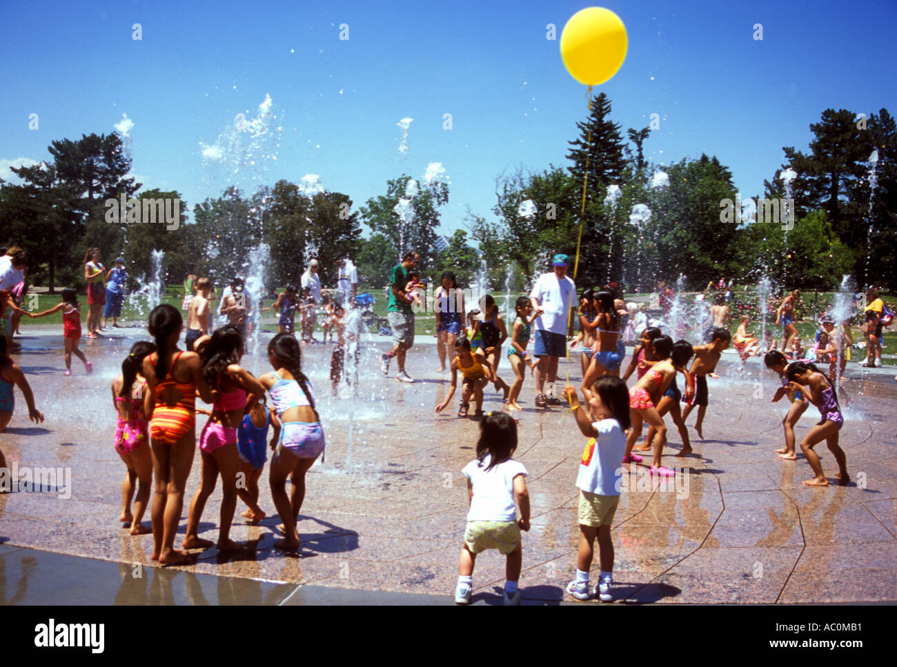 children-playing-in-a-public-fountain-in