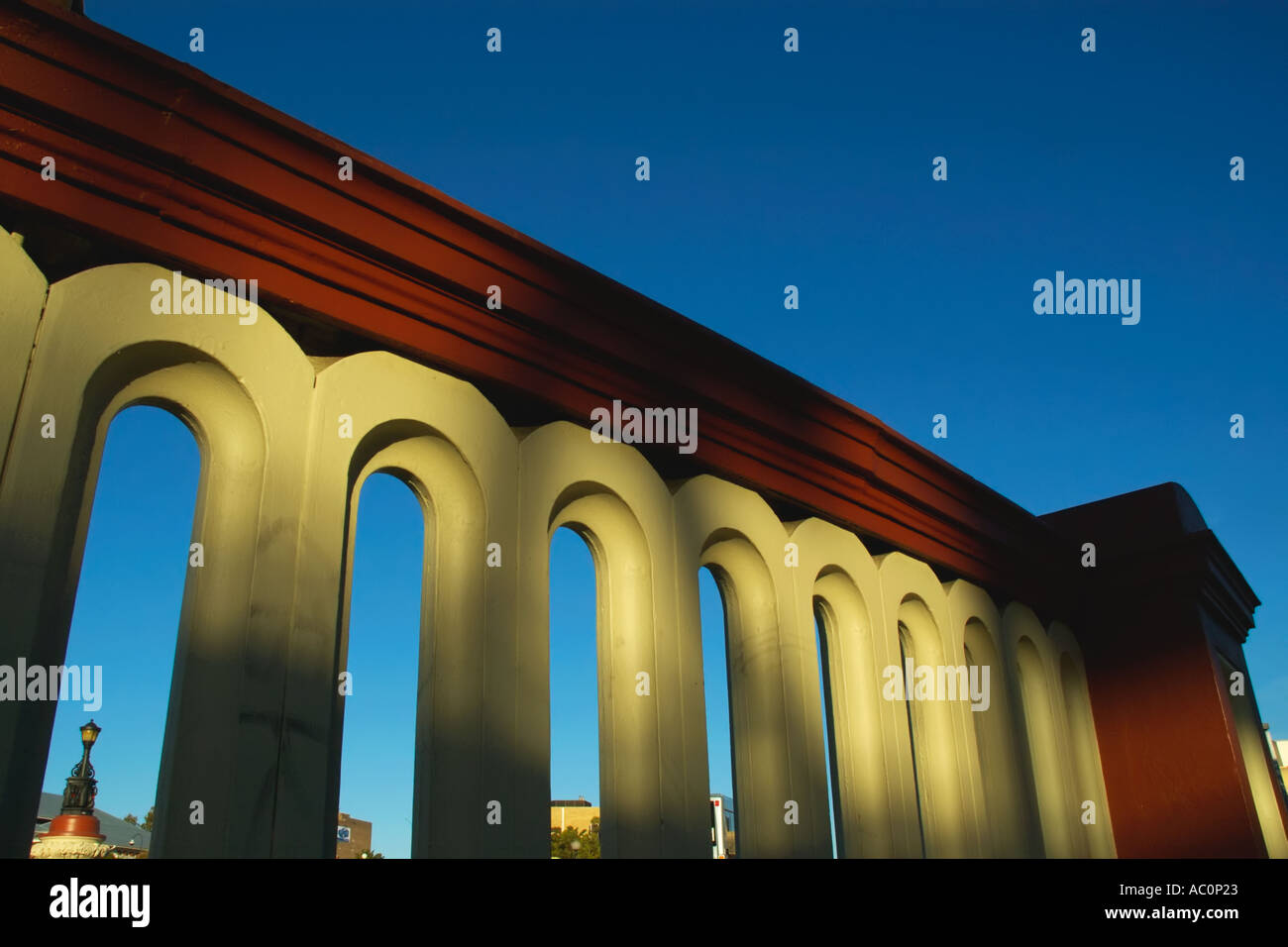 Western Australia Perth Vicinity of Railway Station 19th century style wall with decorative arches in warm afternoon sun - Stock Image