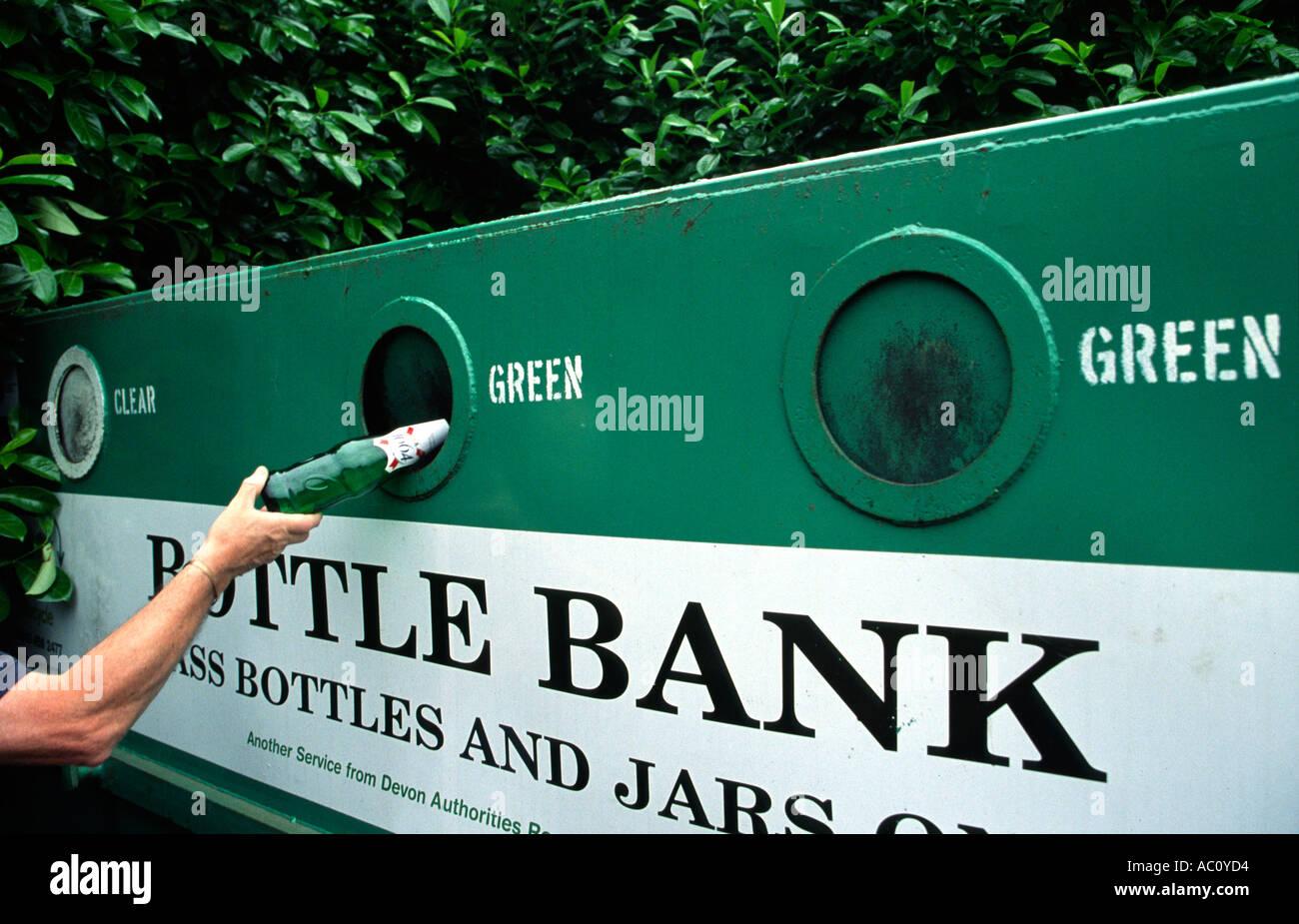 Man deposting bottle in Bottle Bank Devon England - Stock Image