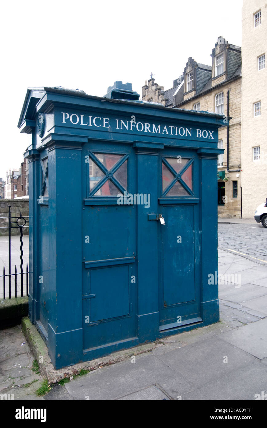 shopping on the grass market street in edinburgh with a blue police information box like the dr who tardis - Stock Image