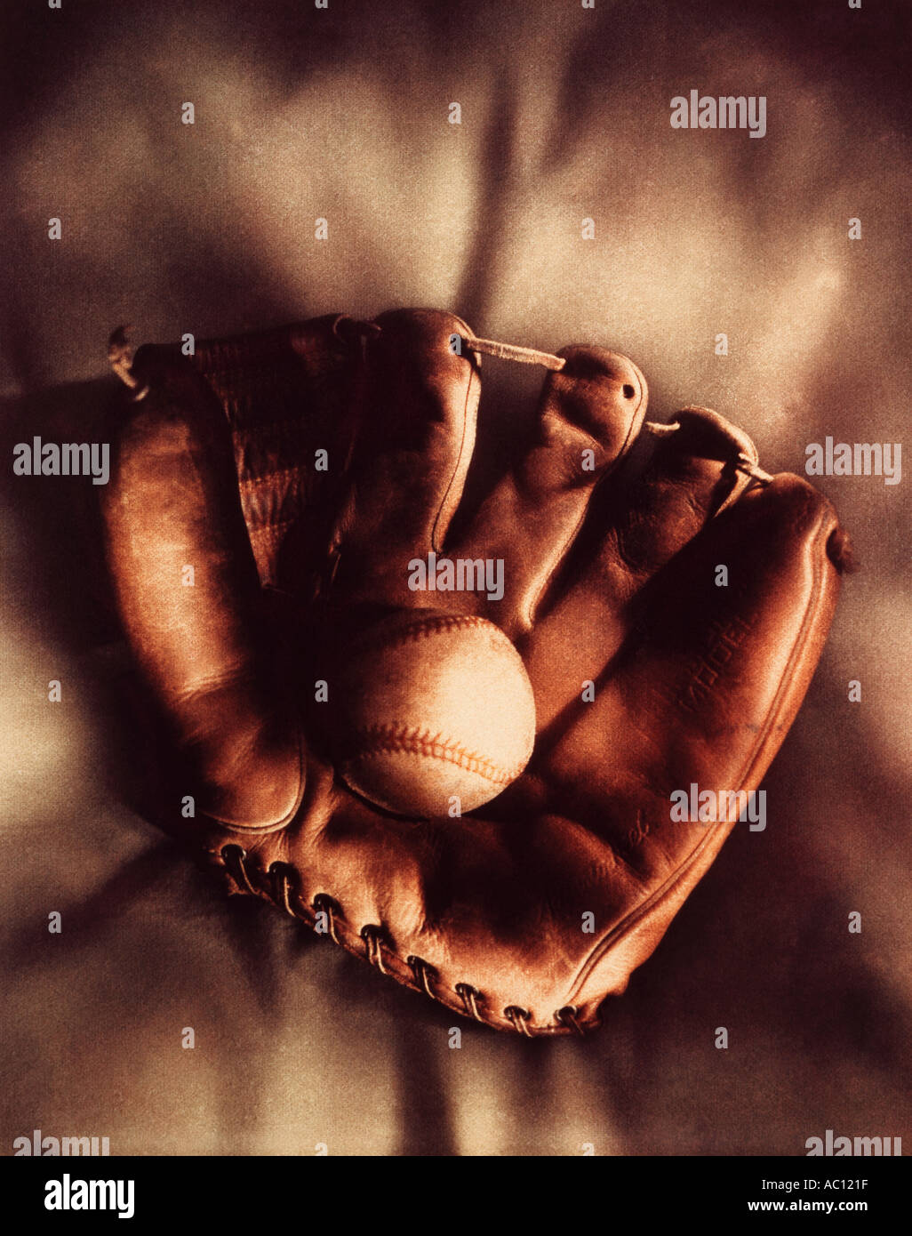 old leather baseball and glove - Stock Image