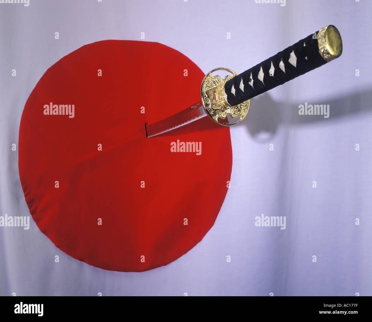Samurai sword in a Japanese flag Stock Photo