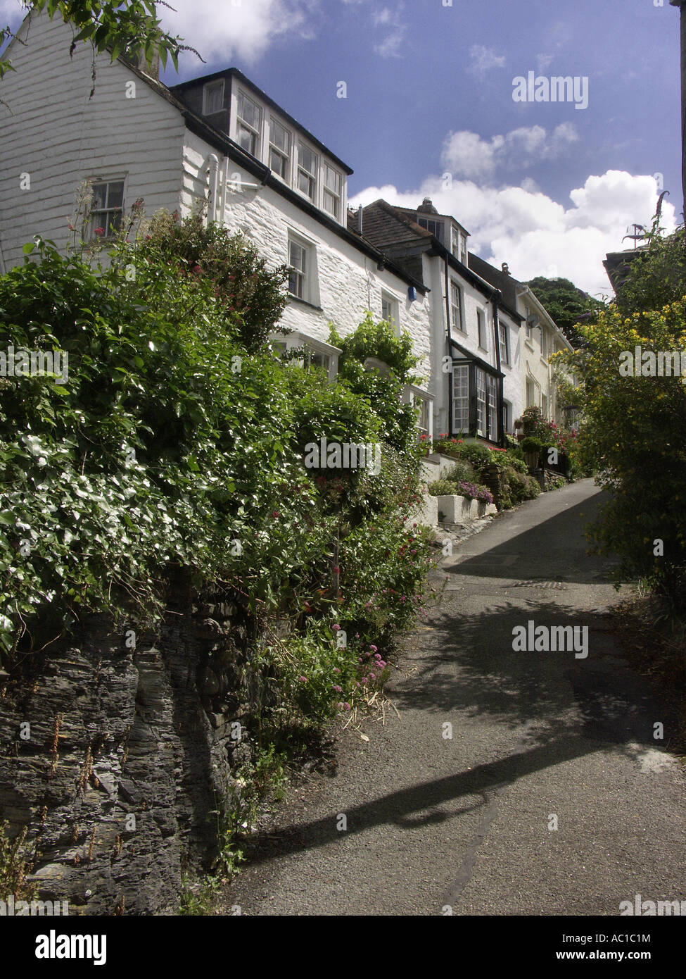 A steep walk home is something the locals have to get used to in Port Isaac. - Stock Image