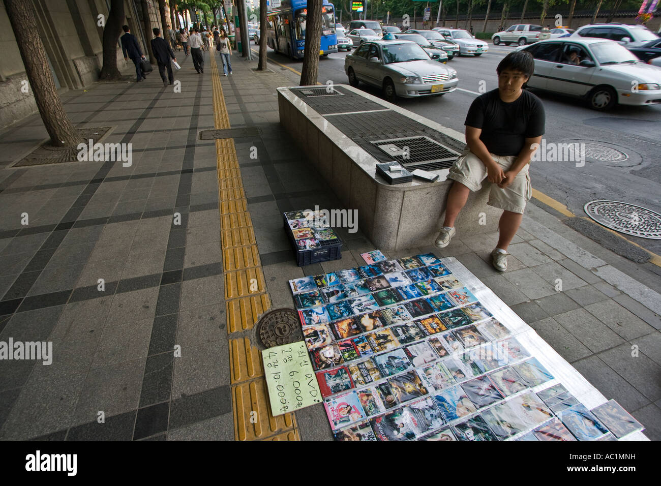 Vendor Selling Counterfeit Bootleg DVD Movies on the Street