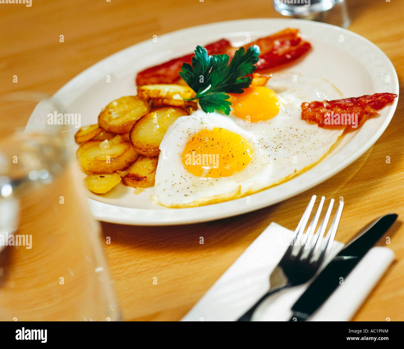 Fried potatotes, eggs and bacon - Stock Image