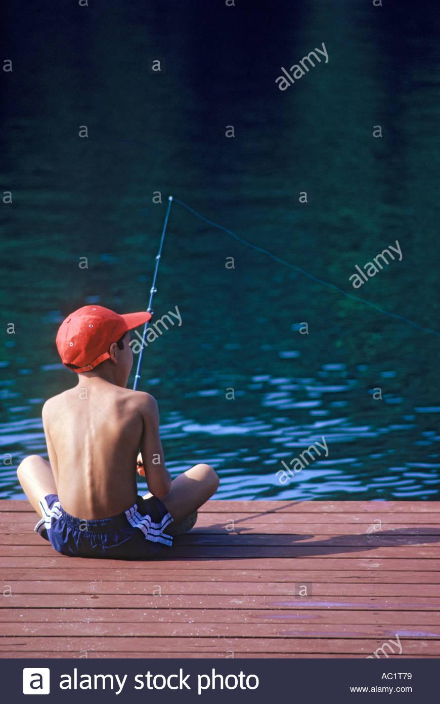 Boy fishing from cottage dock at Long Lake Haliburton