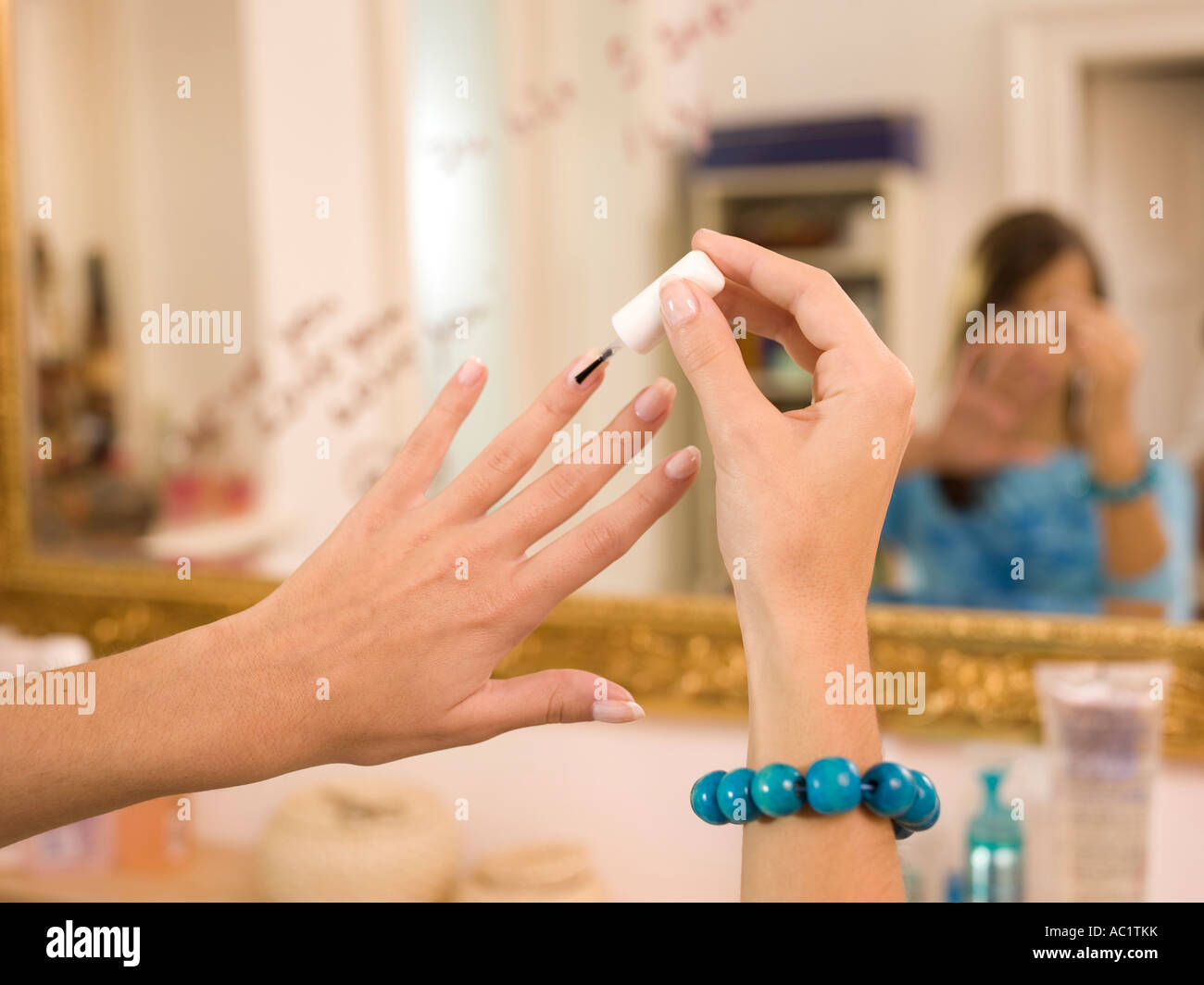 Woman applying nail varnish - Stock Image
