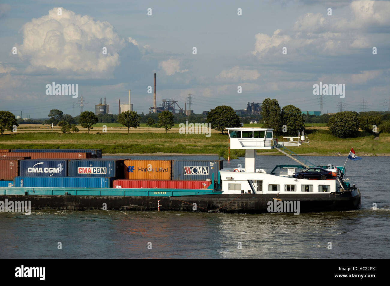 Container transport on the Lower Rhine, Krefeld, Germany. - Stock Image
