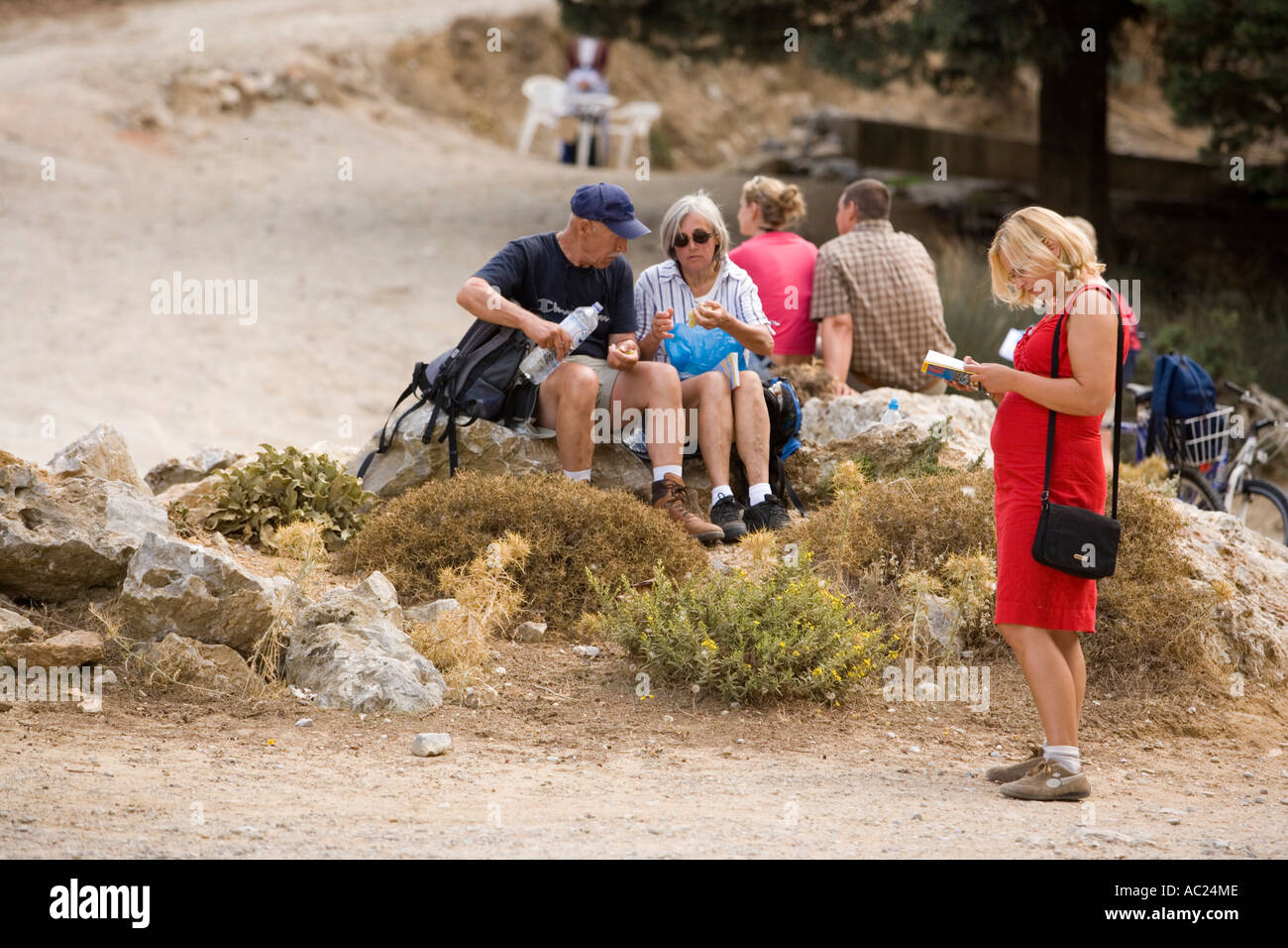 Hikers on the way to the deserted villiage Paleo Pili Kos Greece - Stock Image
