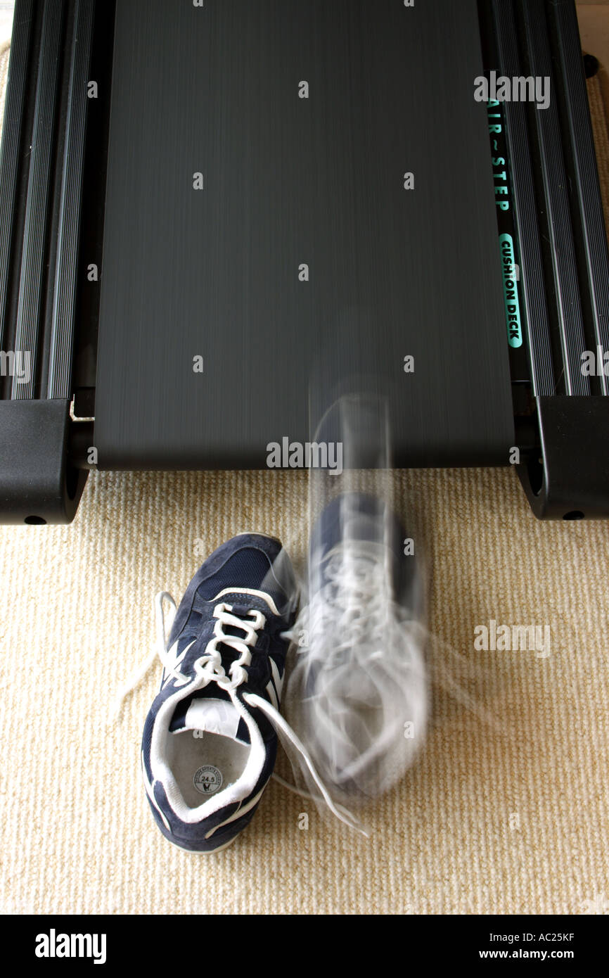 RUNNING SHOES ON A MOVING TREADMILL VERTICAL BAPDB7666 - Stock Image