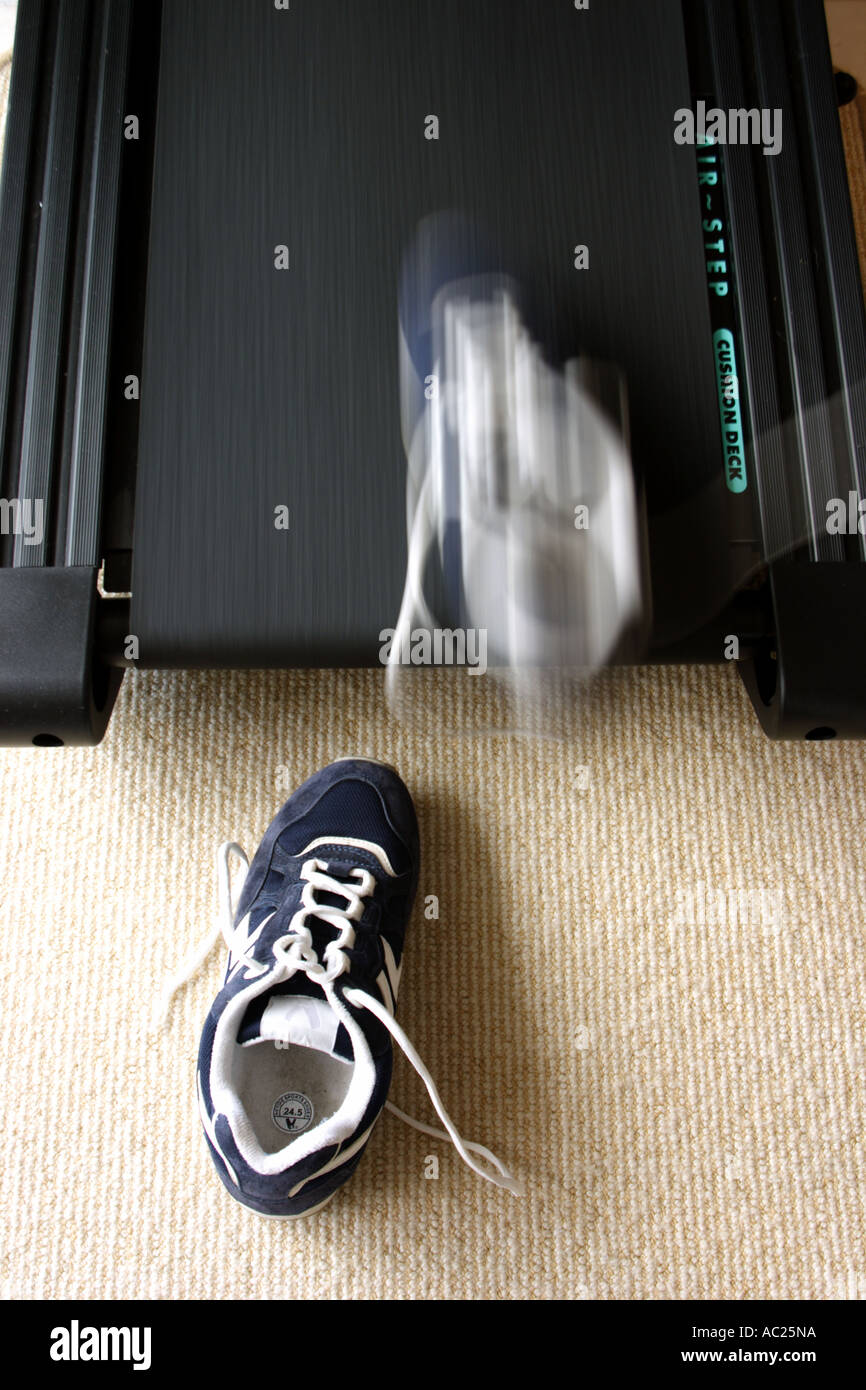 RUNNING SHOES ON A MOVING TREADMILL VERTICAL BAPDB7668 - Stock Image