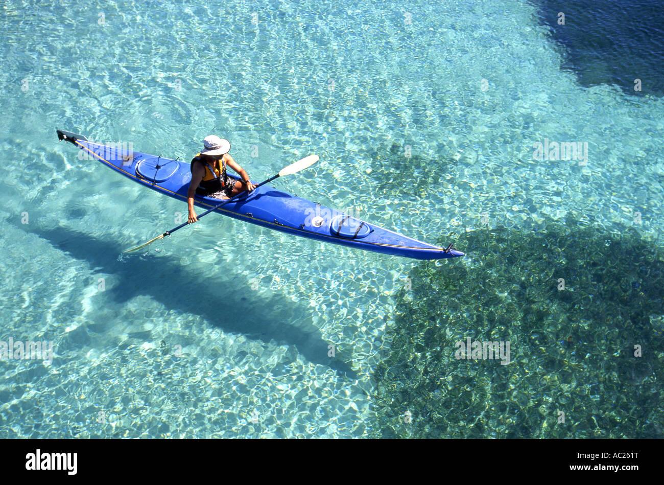 Man kayaking in body of water - Stock Image