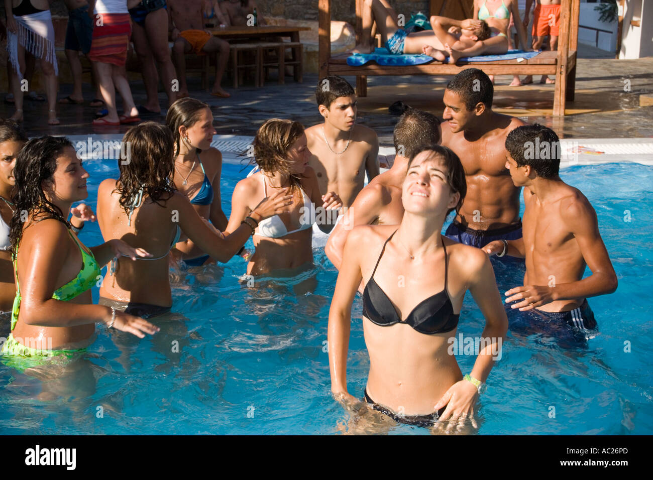 Best Island Beaches For Partying Mykonos St Barts: Young People Dancing During A Beach Party In A Pool Of The