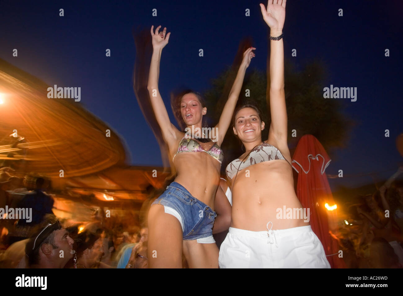 Young people dancing by the full moon party Tropicana Club Paradise Beach Mykonos Greece - Stock Image